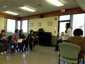 Klara Kim interpreting at a meeting of Korean residents of Longwood.